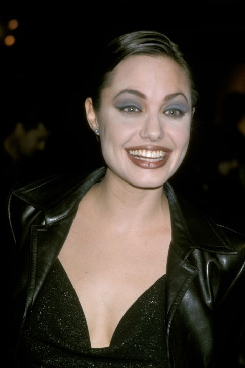 At a <em>Gia</em> screening in January 1998, really enjoying that eye shadow.