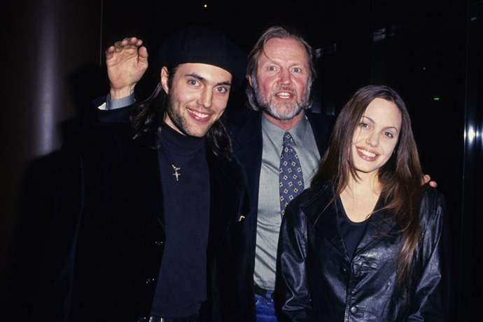 With her brother, James Voight, and father, Jon Voight, at the 25th anniversary party for <em>Midnight Cowboy</em> in February 1994, sporting a snappy leather blazer.