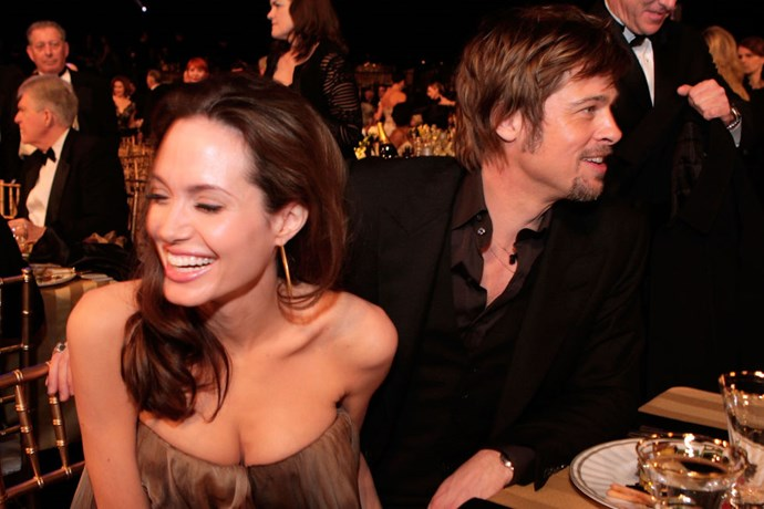 With Brad Pitt at the 2008 Screen Actors Guild awards, giggling again.