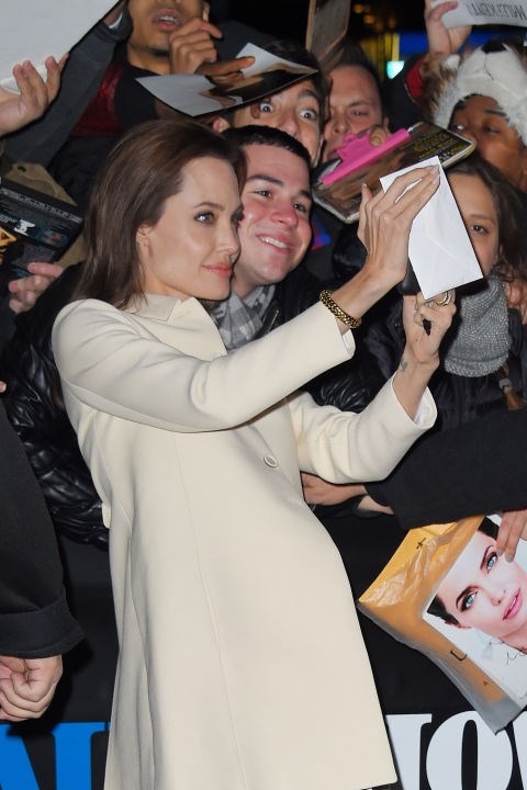 Taking a selfie with a fan outside <em>The Daily Show</em> in December 2014.