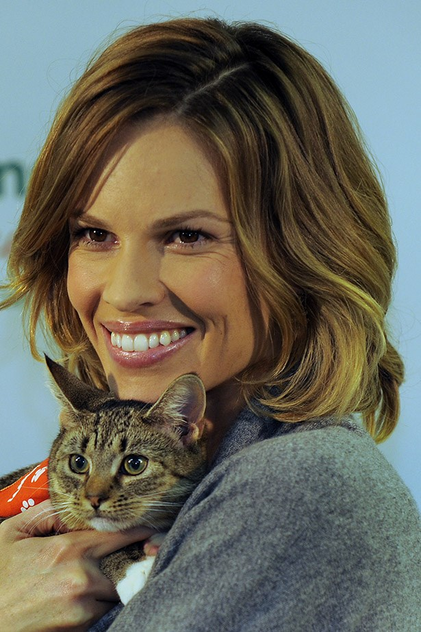 Hilary Swank is an animal lover, here she is at an event to raise awareness for pet adoption. Because who wouldn't want to adopt this little face?!