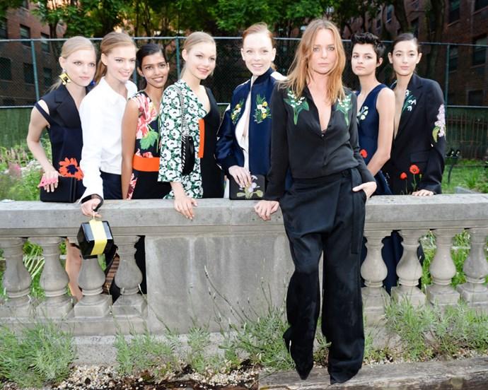 <strong>Designer Stella McCartney flanked by models at her 2016 Resort presentation</strong>