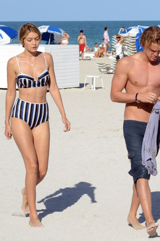 <strong>MARCH 15, 2015</strong> <BR> With Cody Simpson on the beach in Miami in a Solid & Striped bikini.
