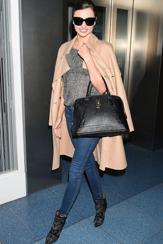 <strong>MIRANDA KERR</strong> <BR> Kerr took the jeans and T-shirt look to new heights, by dressing up her marble grey style and skinny jeans with a trench coat worn on the shoulders, pointed-toe heel boots, and leather bowler bag hanging on the crook of her arm.