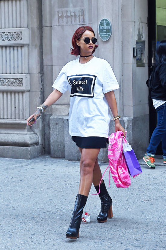 "<strong>RIHANNA</strong> <BR> Rihanna makes a statement in style with a ""School Kills"" emblazoned T-shirt, mini-skirt, and platform boots. We hail this look ""punk luxe."""