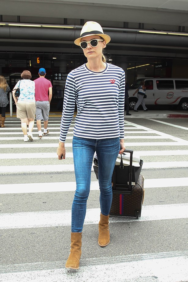 Diane Kruger masters the chic travel look in a Comme des Garcons stripe.