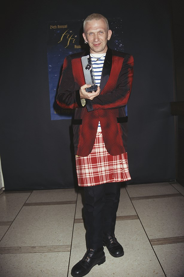 Jean Paul Gaultier's trademark uniform for himself is stripes. Here he is looking glorious in a kilt and stripes circa mid 90s.