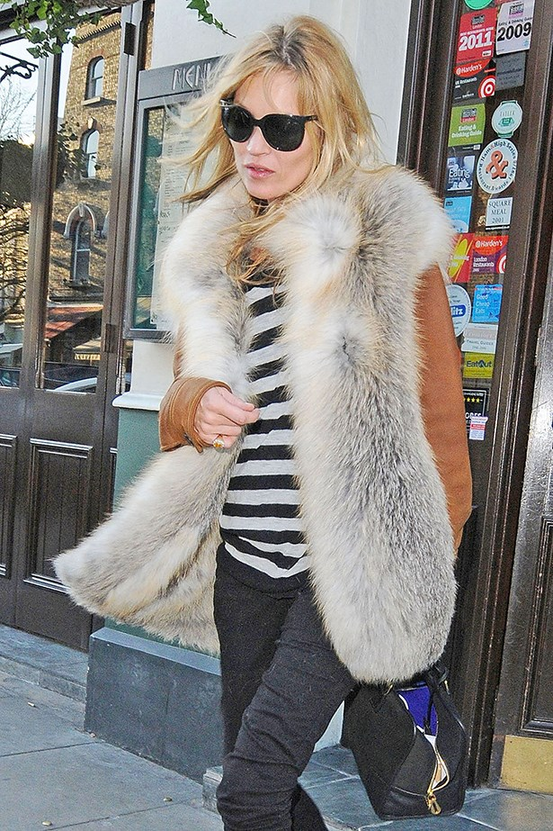 Kate Moss' off-duty outfit is heavy on stripes and cool.
