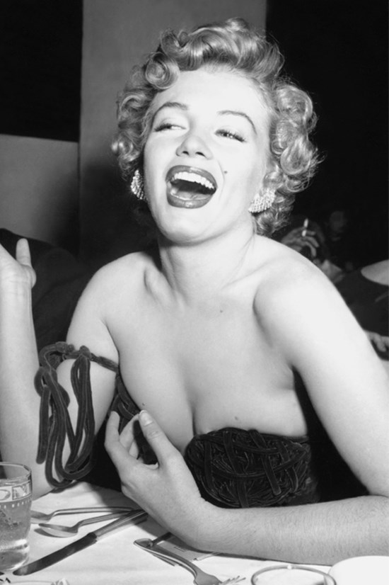 """<strong>MARILYN MONROE</strong> <BR> <BR> According to an interview in 1952 with Pageant Magazine, Marilyn's breakfast consisted of two raw eggs whisked into a cup of hot milk. """"I doubt any doctor could recommend a more nourishing breakfast for a working girl in a hurry."""" <BR> <BR> For lunch (please be seated to read this), Marilyn enjoyed an ice cream sundae… with hot fudge... And for dinner, it was a piece of steak or lamb chops with four or five raw carrots. <BR> <BR> See our full story about Marilyn Monroe's diet <a href=""""http://www.elle.com.au/news/zeitgeist/2015/2/marilyn-monroes-diet-revealed/"""">here</a>."""