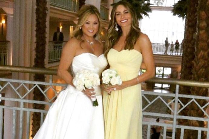 Sofia Vergara played bridesmaid at her friend's wedding in summery yellow.