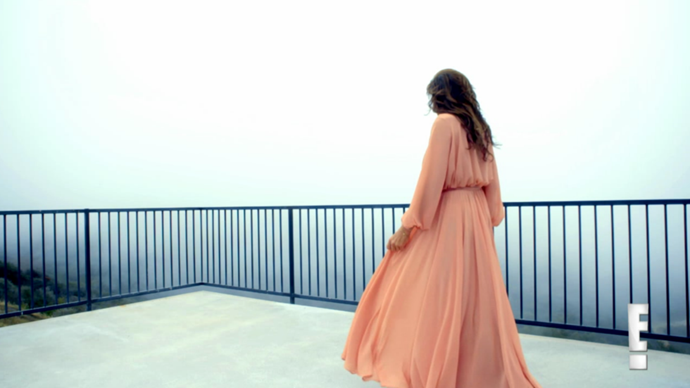 JUNE 2015 In a pink chiffon dress in the second I Am Cait promo. E!