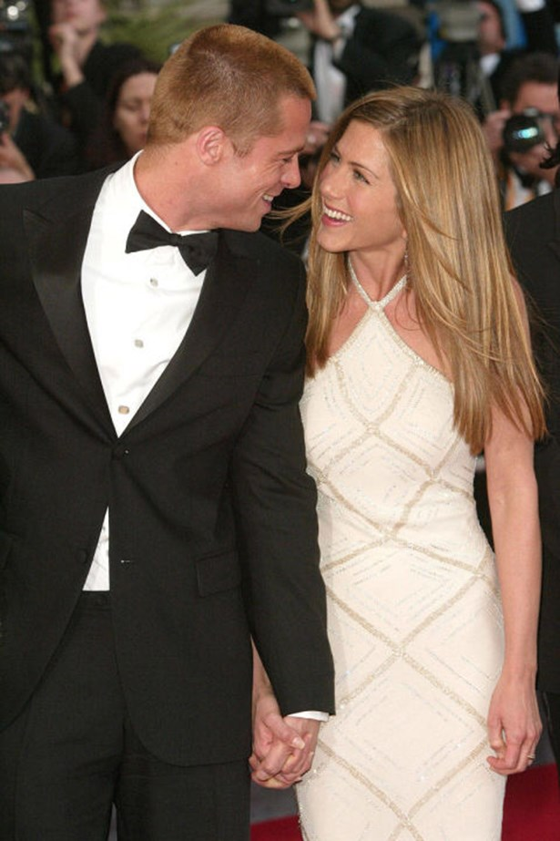 """<strong>BRAD PITT AND JENNIFER ANISTON</strong><br> Brad and Jen: Could there BE a more attractive couple? Well, after Brad met Angelina Jolie while filming Mr. & Mrs. Smith, starred in an editorial titled """"Domestic Bliss,"""" and <em>totally</em> didn't have an affair while Pitt was still married, Hollywood's golden couple broke up in a very public way, and Brad moved on to become one-half of Brangelina. The Jolie-Pitts might not be a more attractivec ouple, but the portmanteau is certainly catchier. Still, #teamjen forever."""