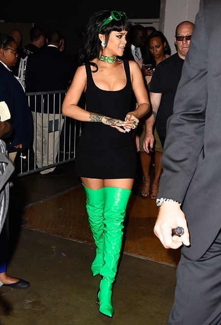 There's only one person in the world who could pull of lime green thigh high boots. Rihanna goes poison ivy in this head-to-toe Versace look.