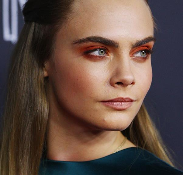 Cara Delevingne wears orange eye shadow