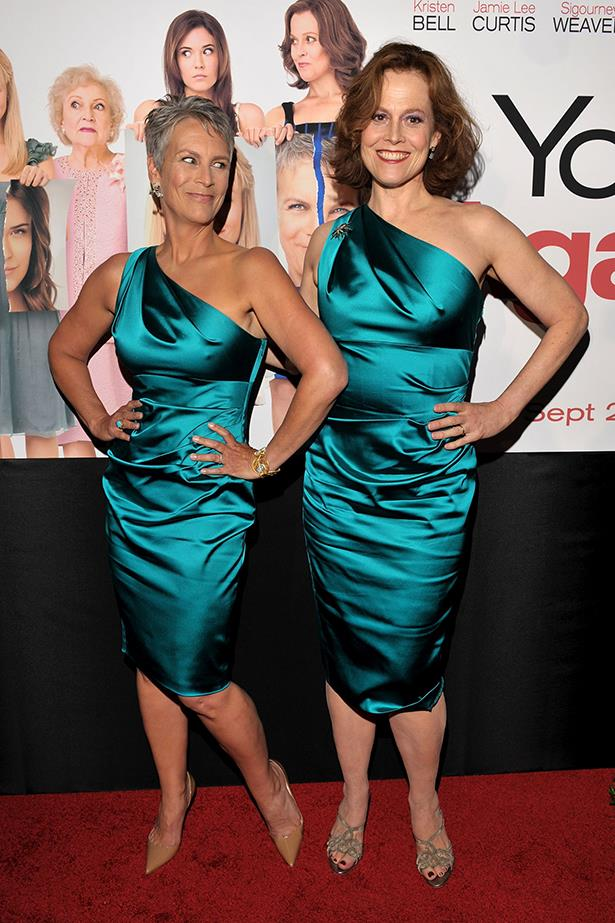 **Jamie Lee Curtis and Sigourney Weaver** <br><br> While this one was clearly intentional, it doesn't make it any less iconic. Both attending their *You Again* movie premiere, Curtis and Weaver appeared in matching teal, one-shoulder dresses.