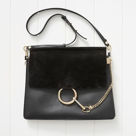 "The Chloé Faye bag I bought in London is still my every day go to. Bag, $2156, Chloé, <a href=""http://www.matchesfashion.com/products/Chlo%C3%A9-Faye-leather-and-suede-shoulder-bag-1018612"">matchesfashion.com</a>"