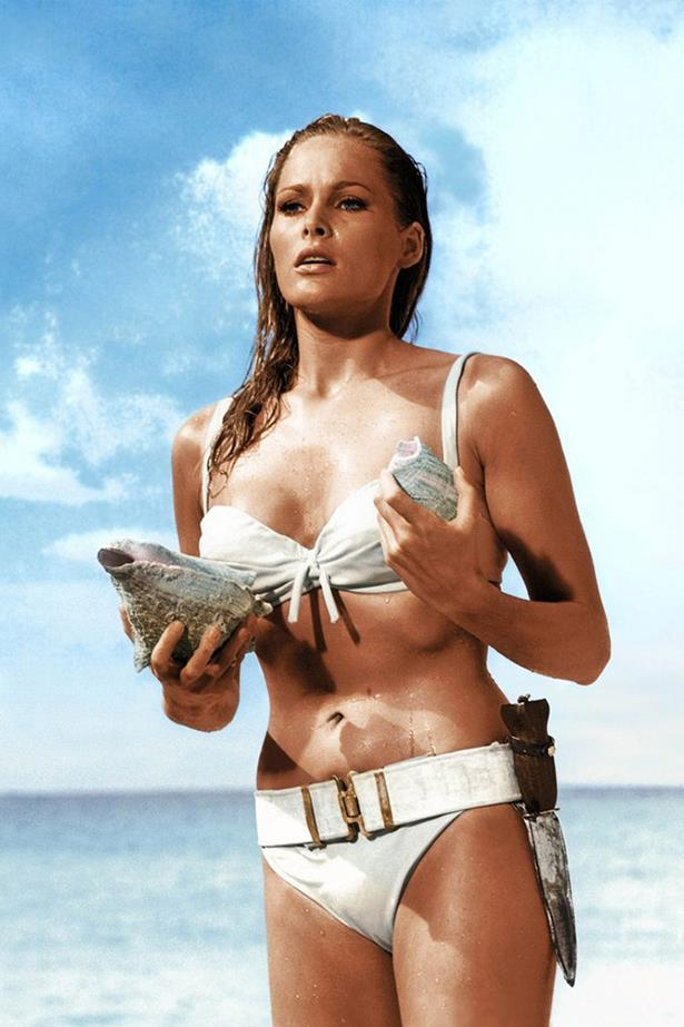 Did anyone else want to strap a knife to our swimsuits after this, or just us? Ursula Andress in *Dr. No* showed us how it was done.