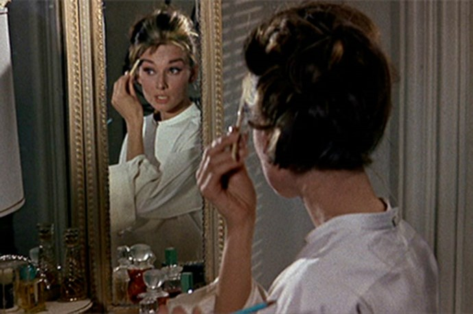 <strong>Breakfast At Tiffany's </strong> <br> <br> Watching <em><strong>Audrey Hepburn's</strong></em> <em>Holly Go Lightly</em> touch up her makeup in this classic movie is beyond mesmerizing.