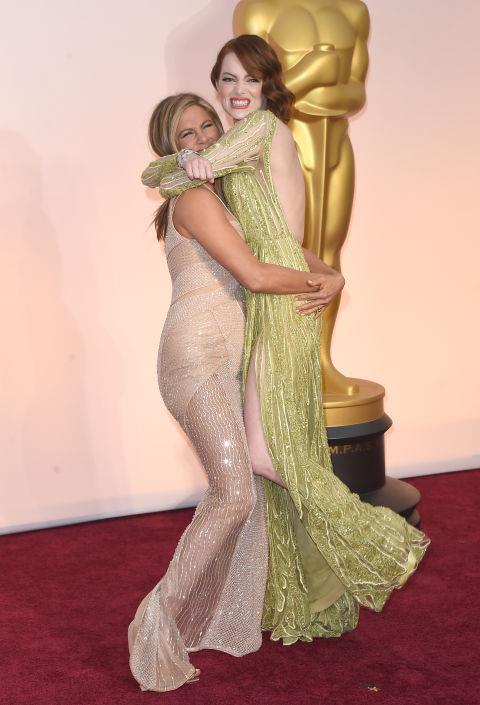 "JENNIFER ANISTON AND EMMA STONE. ""You lift me up"" friends."