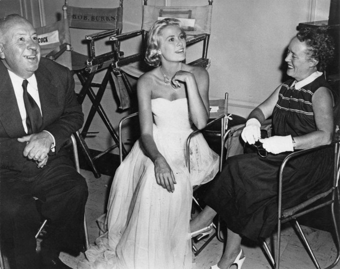 On the set of To Catch a Thief with director Alfred Hitchcock and his wife, Alma Reville, in 1954.