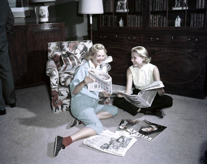 15.	Reading magazines with a friend in 1954.