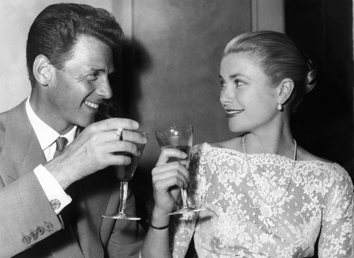 Clinking glasses with French actor Jean-Pierre Aumont on May 13, 1955.