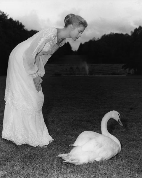 Posing with a swan on the set of The Swan in 1956.