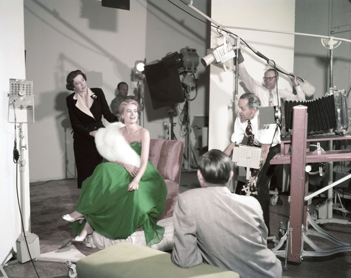 Wearing a green dress for St. Patrick's Day during a photo shoot in 1954.