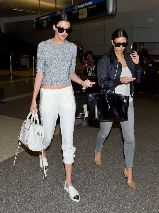<p>July 10, 2014</p> <p>Kendall Jenner and older sister Kim Kardashian seen at LAX.</p>