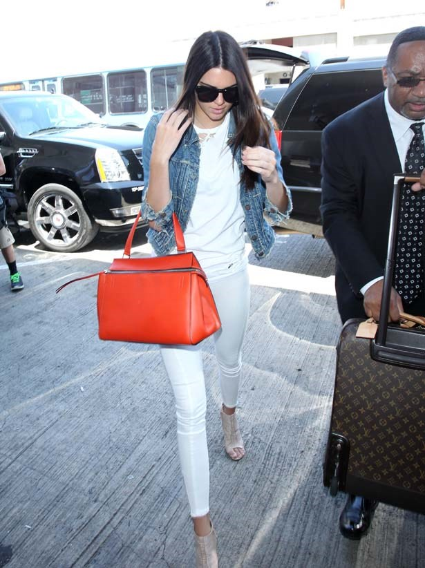 <p>July 31, 2014</p> <p>Kendall Jenner wears white denim and with a Celine handbag in Los Angeles.</p>