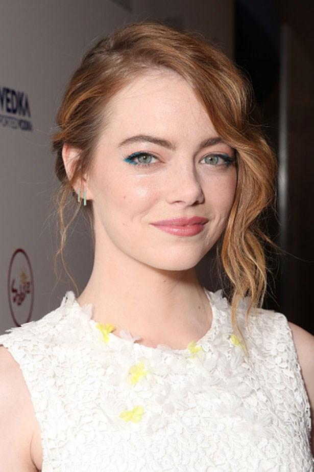 <strong>Emma Stone</strong> <br> <br> <em>Aqua-sliced eyes and pulled back curls</em>