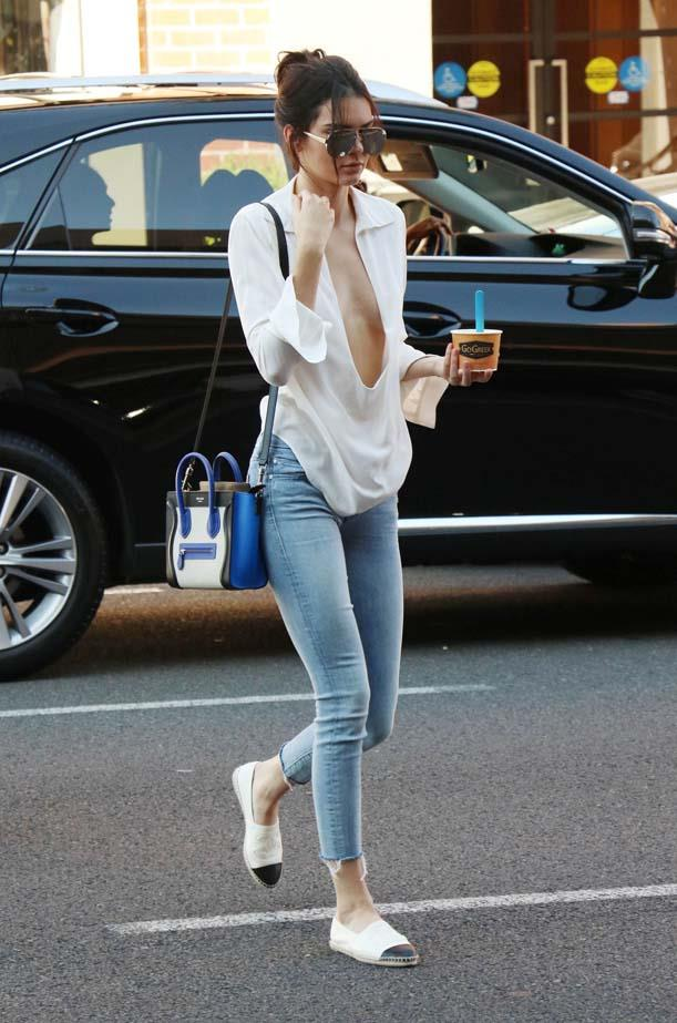 <p>July 14, 2015</p> <p>Kendall Jenner wears a seriously low-cut top in LA while on a frozen yoghart run.</p>