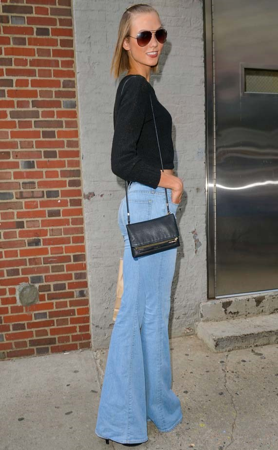 The supermodel knows how to style her denim flares.
