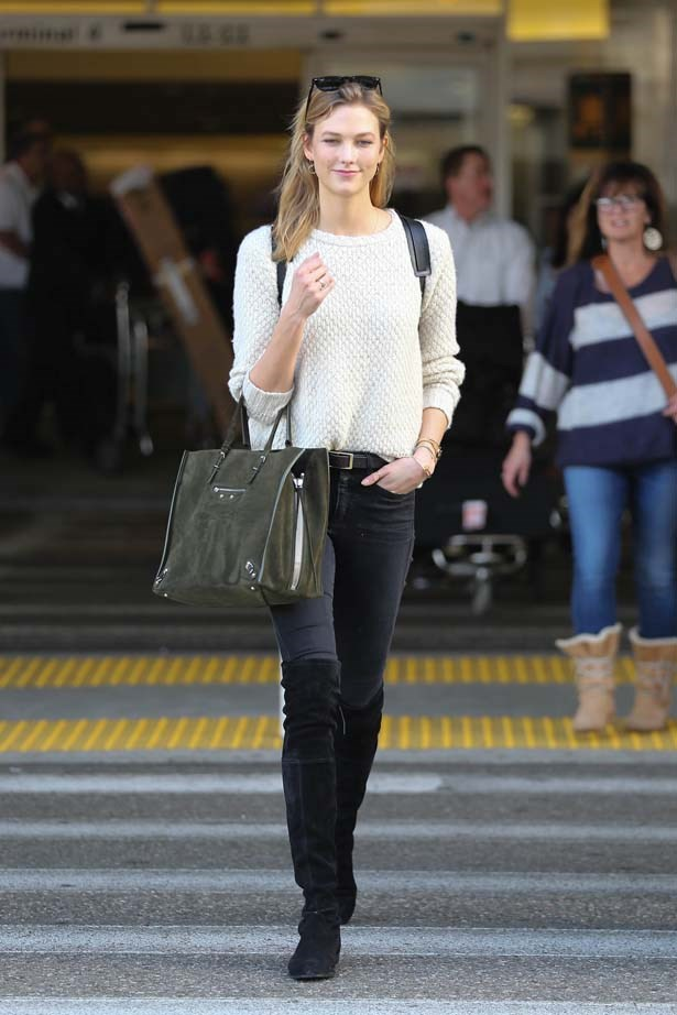 Kloss's suede knee high boots have us dreaming.