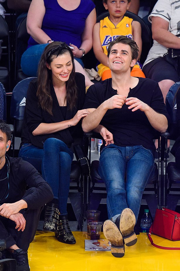 <p>Here she dresses them down to a basketball game with her rumored fiancé Paul Wesley.</p>