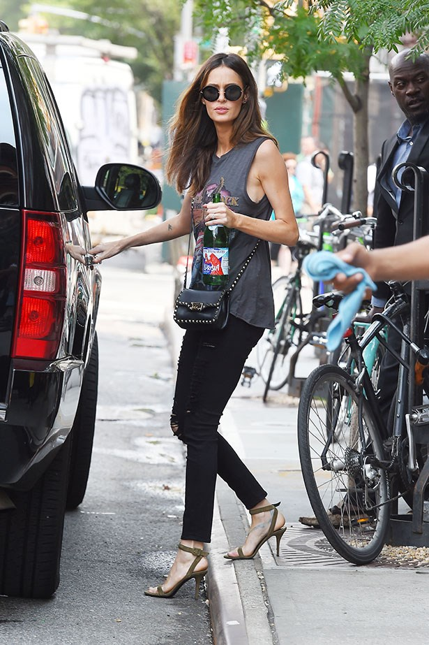 "<p>Nicole Trunfio always nails the effortless rock-chic look with the help of her two favorites: her <a href=""http://shop.nordstrom.com/s/valentino-rockstud-crossbody-bag/3713911?cm_ven=Linkshare&cm_cat=partner&cm_pla=10&cm_ite=1&siteId=oGj7akNVsTg-3OmlMOojcasgN1mnSeYTzA"">Valentino Cross Body Rockstud Bag</a> and <a href=""http://www.alexanderwang.com/us/shop/women/shoes-heels-antonia-suede-pump_cod44718931eh.html"">Alexander Wang Suede pumps</a>.</p>"