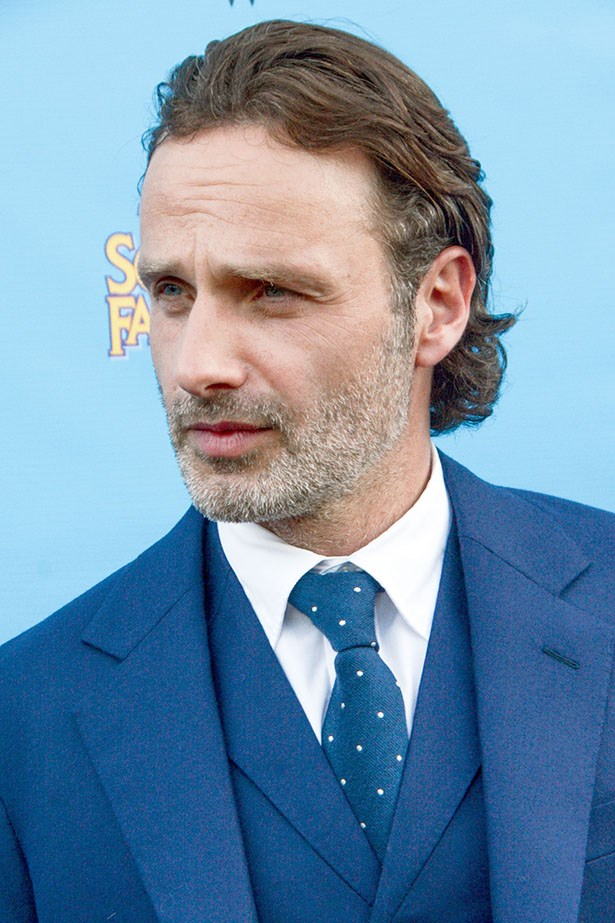 The Walking Dead's Andrew Lincoln, grizzled stubble, pushed back hair, dapper suit.