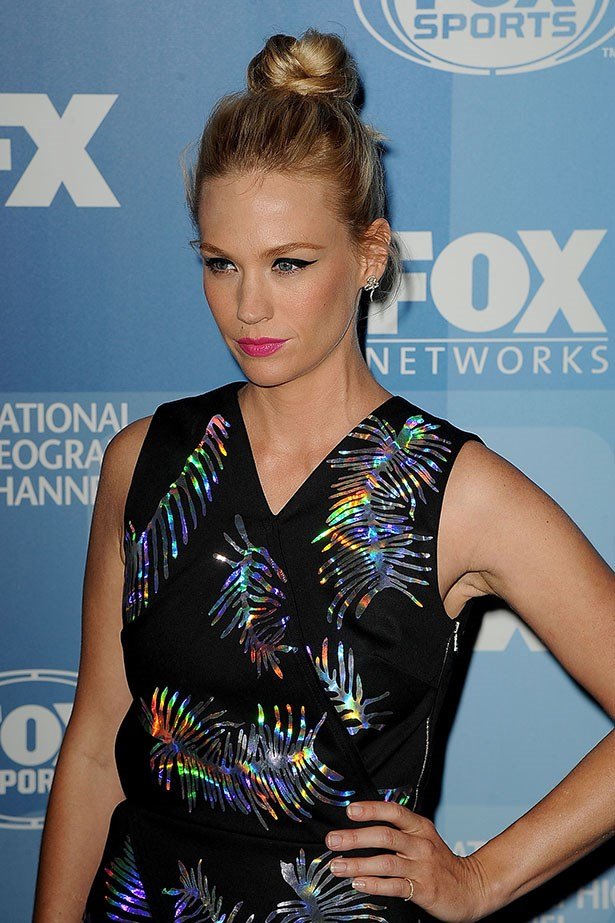 January Jones was recently the subject of an article asking why she looks so miserable all the time. She's probably happy! Leave her be.