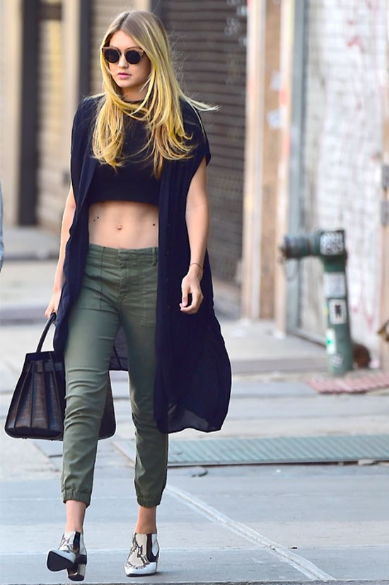 Gigi Hadid was spotted in New York donning a crop top with an oversized vest and khaki ¾ pants. Follow in Gig's footsteps (literally) and add a statement shoe to make your neutrals pop.