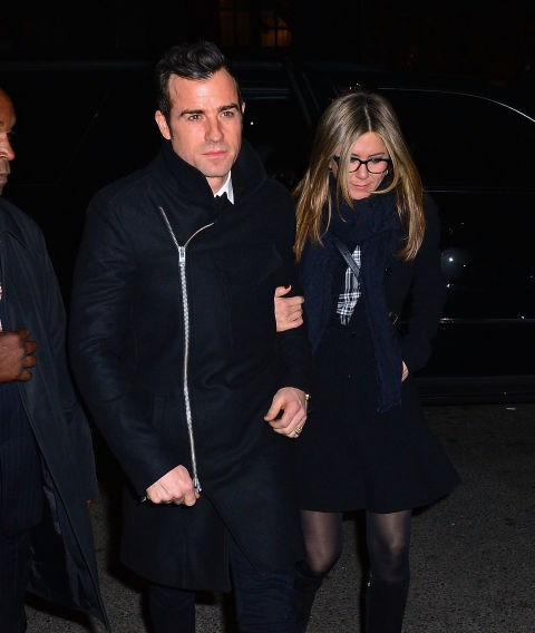 NOVEMBER 16, 2014 Casual, bundled all-black everything with Justin Theroux.
