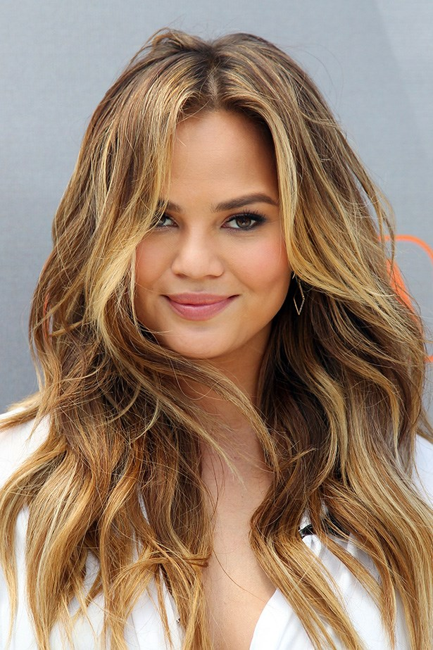 <strong>Chrissy Teigen's</strong> gorgeous, sun-kissed hair has us in a Summer daze.