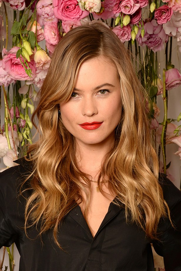 <strong>Behati Prinsloo's</strong> beautiful glossy hair gives us major mane envy and is super versatile as a summer, transition shade.
