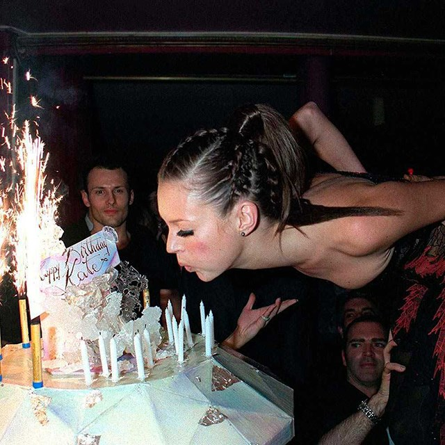 Kate Moss lifted to heights for her cake.