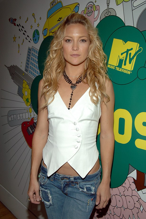 This photo of Kate Hudson circa 2003 is mostly about the jeans so that we never forget, but also you sometimes liked to wear your hair really curly. Image: Getty