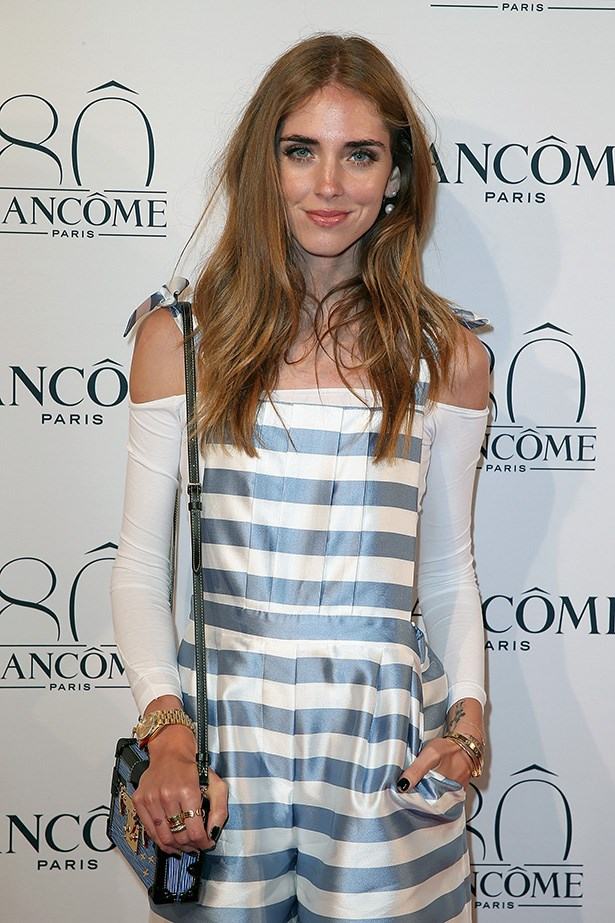 Chiara Ferragni teams a sleeveless basic tee with a strappy dress for a super cute look.