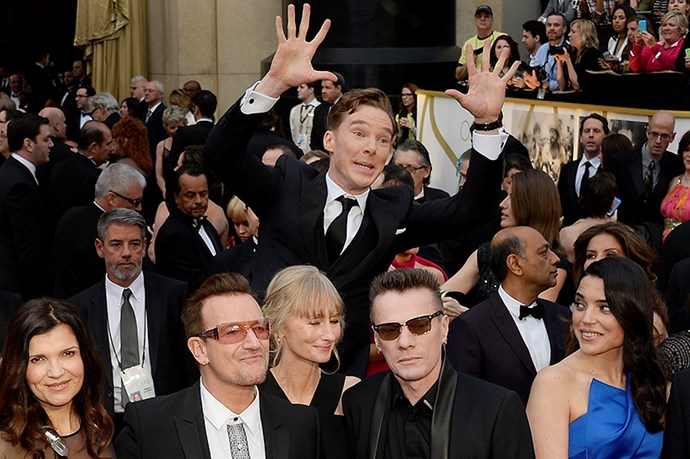A perfectly constructed photobomb by Benedict Cumberbatch using U2 as props.