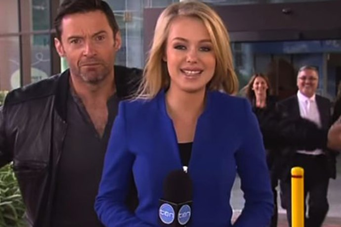 Aussie treasure Hugh Jackman delighted the world by photobombing a channel 10 reporter during a live broadcast. Image via channel 10.