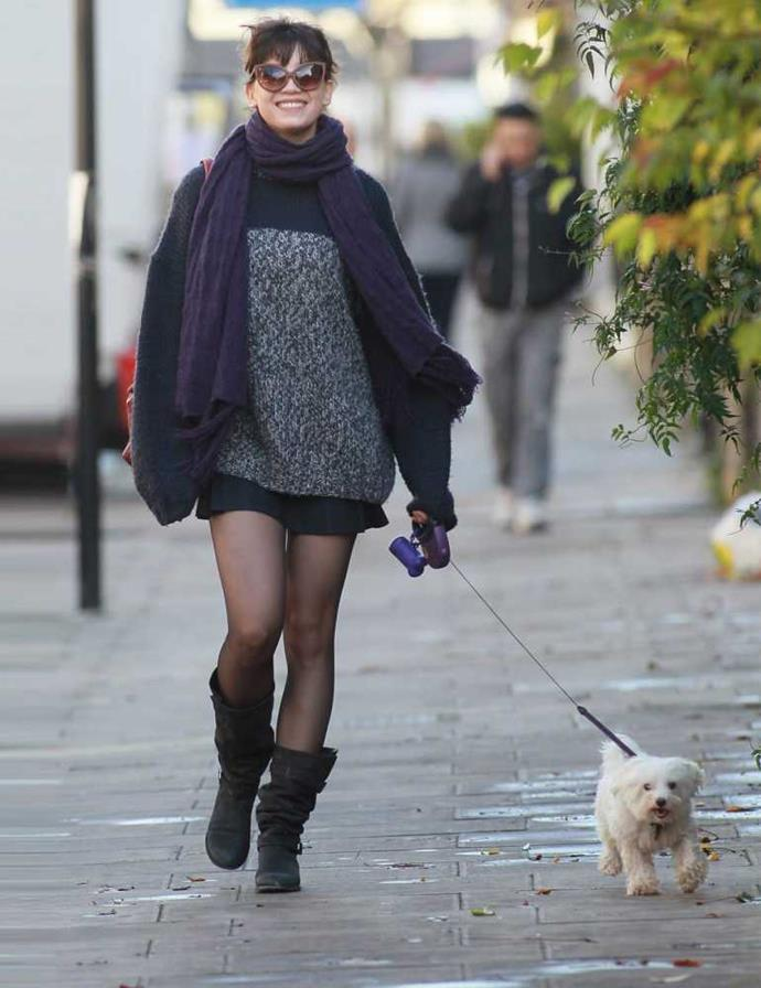 Daisy Lowe takes her dog Monty for a walk in London.