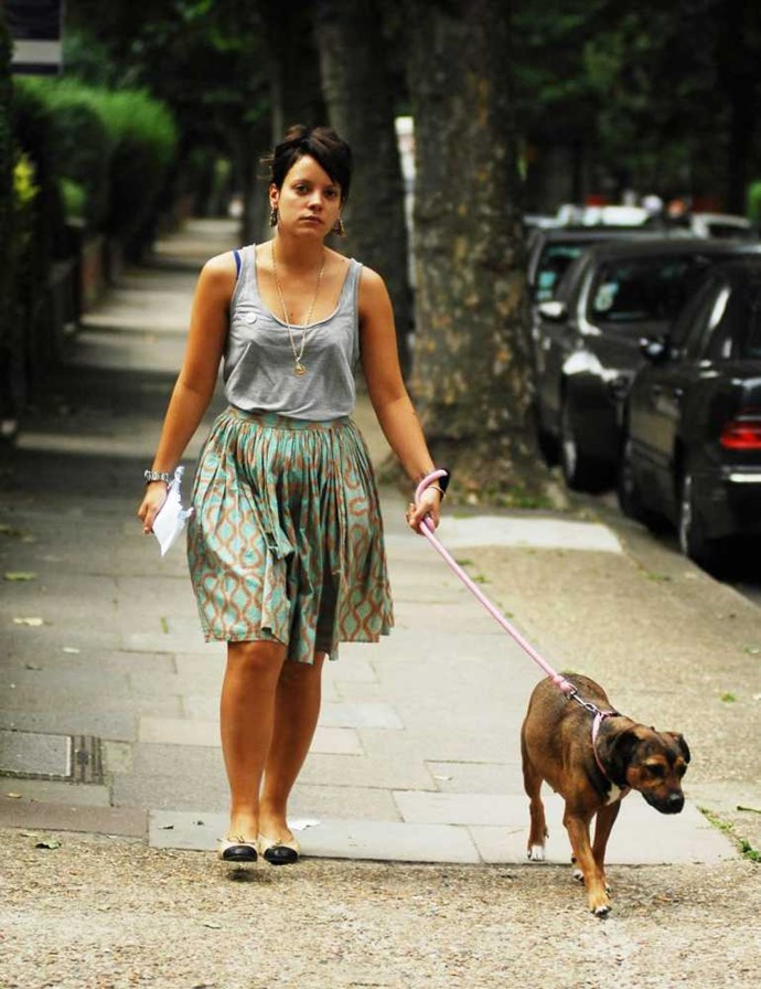 Lily Allen walking her dog Mabel.