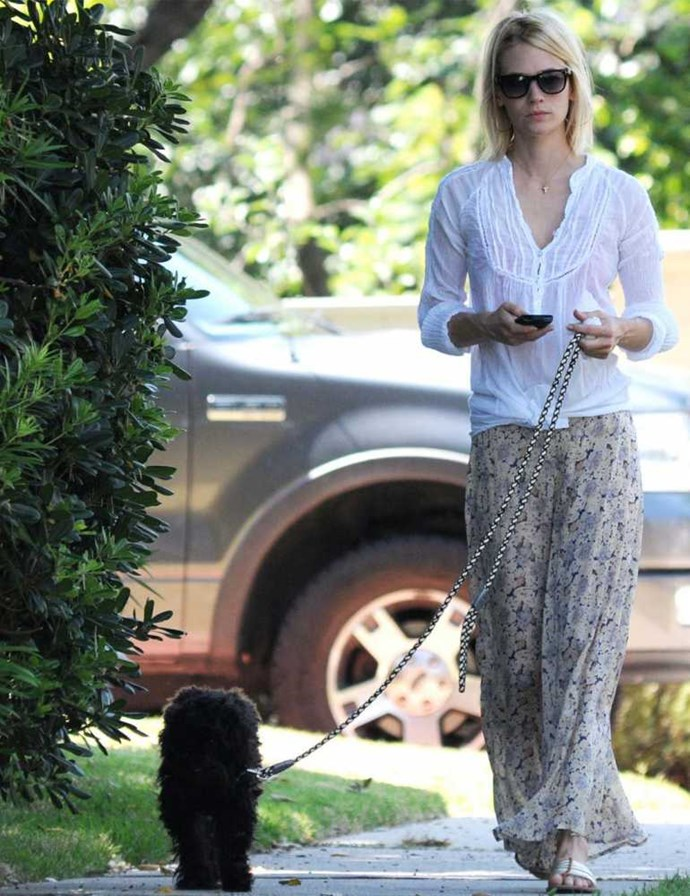 January Jones walking her fluffy dog.